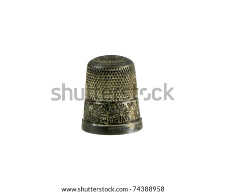 antique ornate sterling silver thimble on a white background