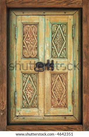 Antique ornate wooden window shutters - stock photo