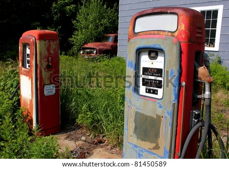 antique pair of gas pumps and truck - stock photo