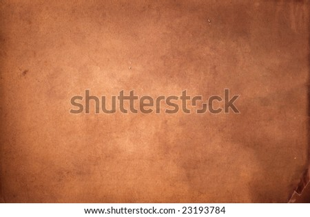 Antique paper suitable as a background texture. - stock photo
