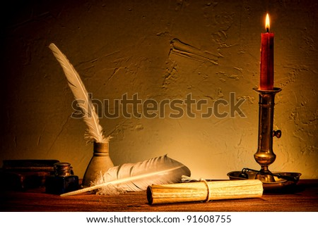 Antique parchment paper sheets roll tied with string lit by candlelight on a vintage colonial wood desk with ink writing feather quill and old candle light in candleholder in master painting style - stock photo
