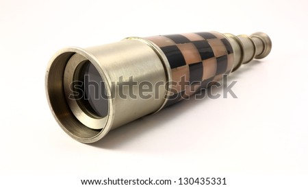 Antique pewter and mosaic nautical telescope on white background