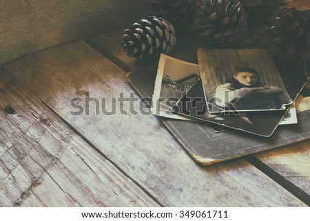 antique photos  on wooden table. faded style filtered image. selective focus - stock photo