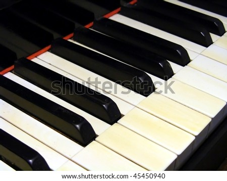 Antique Piano keyboard. - stock photo