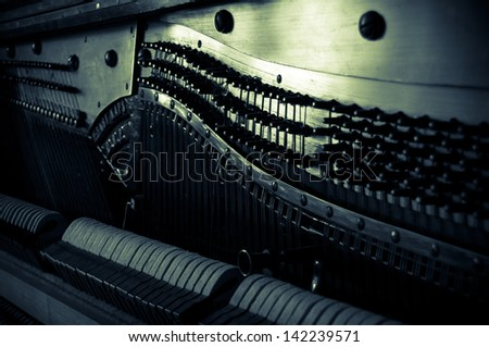 Antique piano - tuning a musical instrument. Vintage musical background - old piano inside.  - stock photo