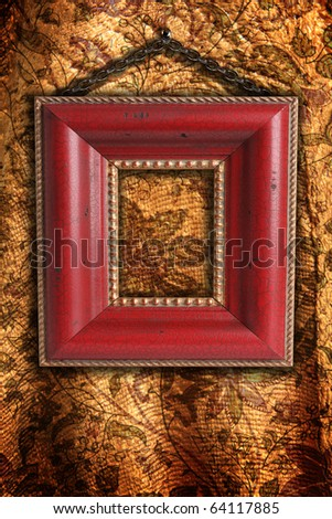 Antique picture frame on vintage floral fabric. - stock photo