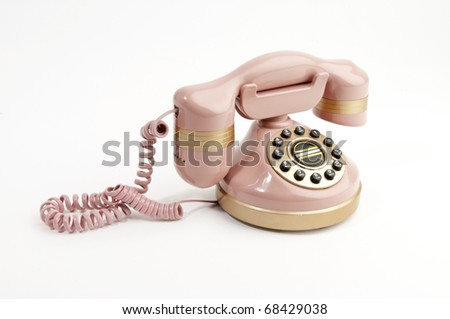 Antique pink phone isolated on white - stock photo