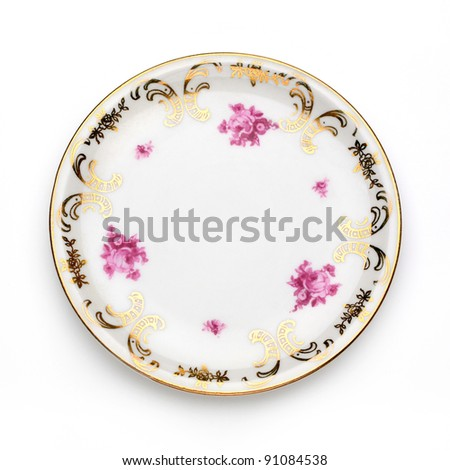 Antique plate on white background - stock photo