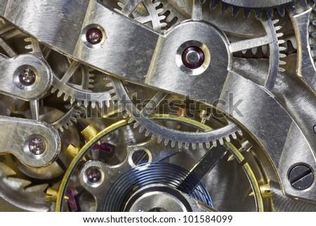 Antique pocket watch inside gears macro detail. - stock photo