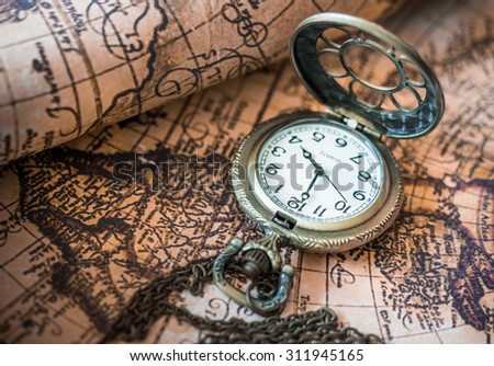Antique Pocket Watch On Ancient Map Background. - stock photo