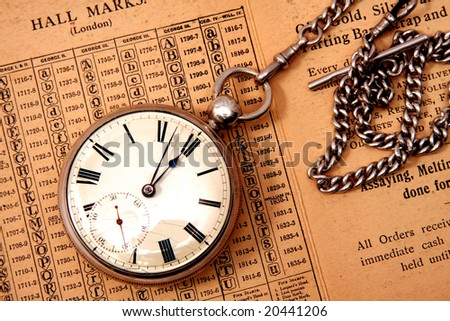 Antique pocket watch on chain. - stock photo
