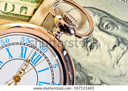 antique pocket watch on the dollar - stock photo