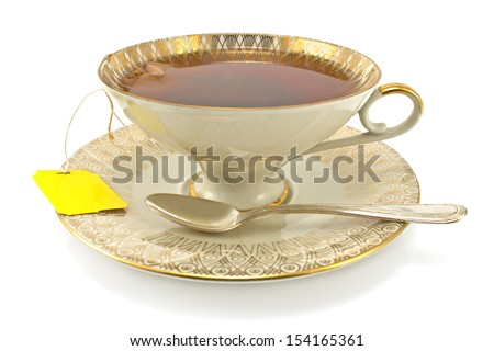 Antique porcelain  cup with tea  isolated on white - stock photo