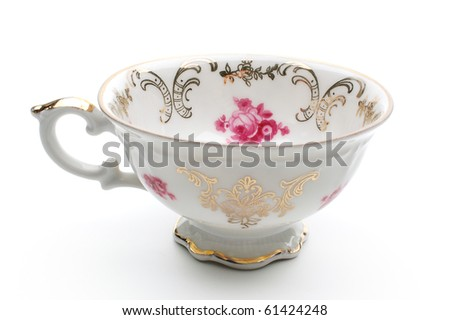 Antique porcelain tea cup on white background - stock photo