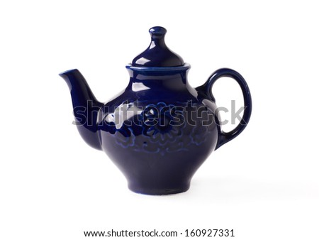 antique porcelain teapot blue on a white background - stock photo