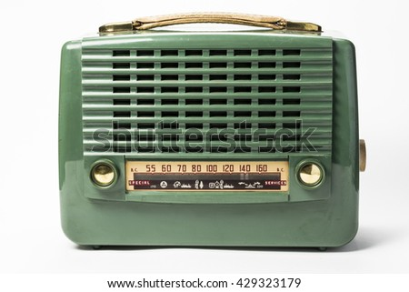 Antique portable plastic dual-band tube radio with handle 1950's