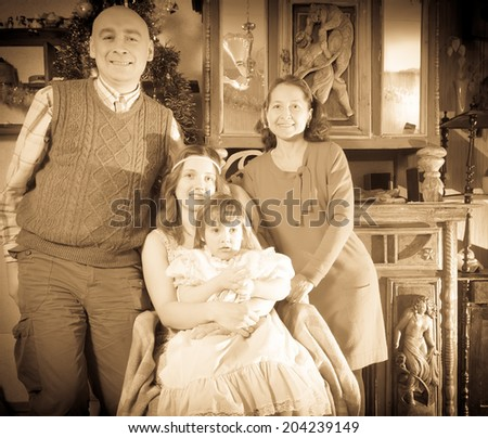 antique portrait of happy family with Christmas tree at home