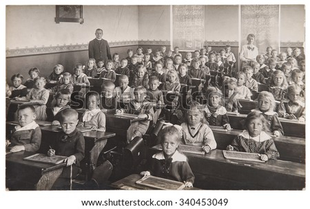 Antique portrait of school classmates. Group of children and teachers. Vintage picture with original film grain and blur - stock photo