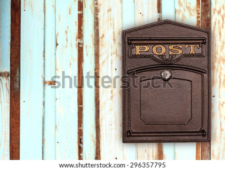 Antique Post BOX on the wood texture - stock photo