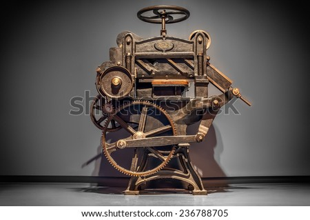 Antique printing press over grey background with vignette. - stock photo