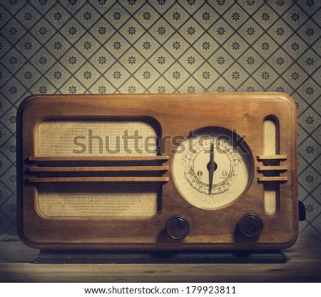Antique radio on retro background - stock photo