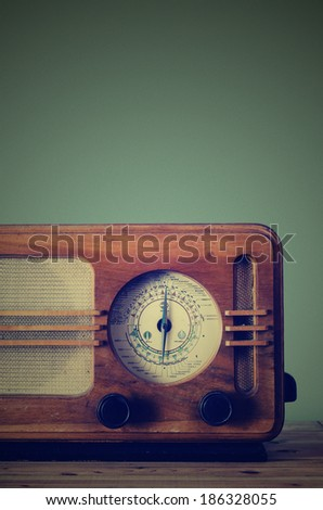 Antique radio on retro background. grain texture added. - stock photo