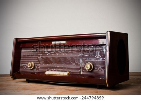antique radio on vintage background.