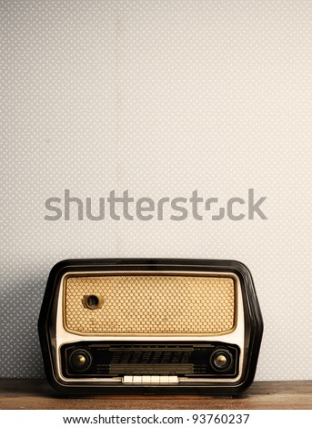antique radio on vintage background - stock photo