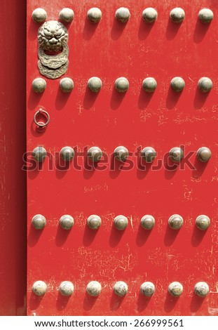 Antique Red Chinese door in Forbidden City, Beijing, China - stock photo