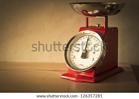 Antique red kitchen scales - stock photo