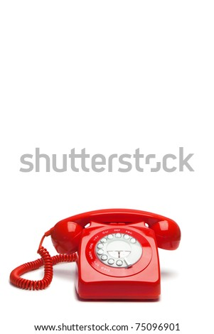 Antique red phone on a white background - stock photo