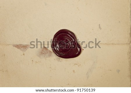 Antique red wax seal on old vintage grunge paper background. Secret, security concept. - stock photo