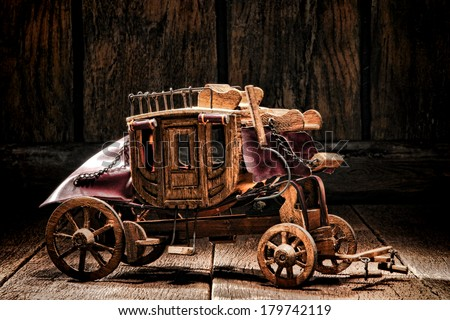 Antique reproduction miniature western stagecoach wagon artisan made craft wood toy crafted by old West frontier native American Indian craftsman - stock photo