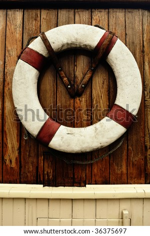Antique rescue boy on an old ship - stock photo