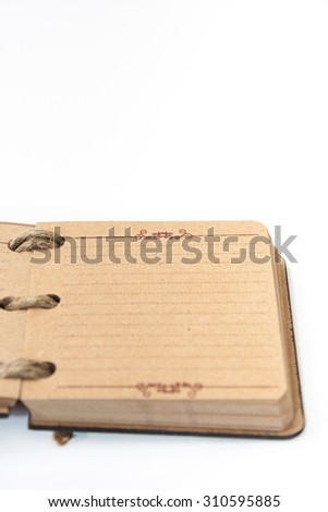 Antique retro diary bound with rope.