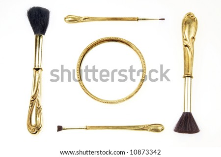 Antique retro makeup brush set and small pocket mirror isolated on white background - stock photo