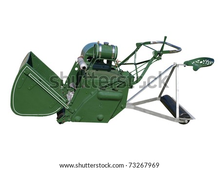 Antique Ride-on Lawnmower isolated with clipping path - stock photo