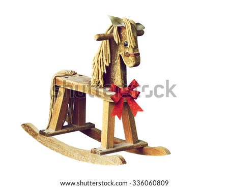 Antique rocking horse with red Christmas bow, isolated on white.