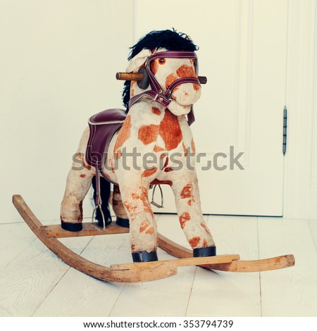 Antique Rocking Horse, Wooden Fabric Toy. Old Vintage Traditional Gift - stock photo