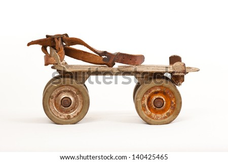 antique roller skate isolated on white side view - stock photo