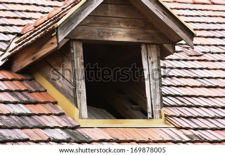 Antique roof window to the attic. - stock photo