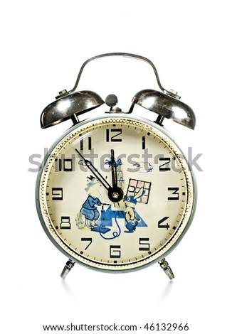 Antique Russian alarm clock with cartoons isolated on white - stock photo