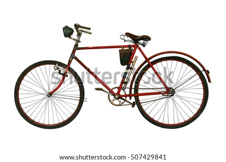 Antique rusted bicycle isolated on a white background. Retro red bike. Old used bike with spotlight on alternator. Historical a bicycle ready for biking.