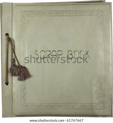 Antique scrapbook with tassels and grunge intact. Work path. - stock photo