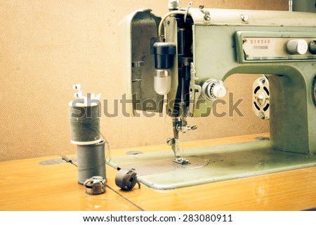 Antique sewing machine in work shop
