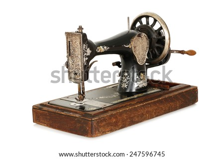 antique sewing machine isolated on white - stock photo