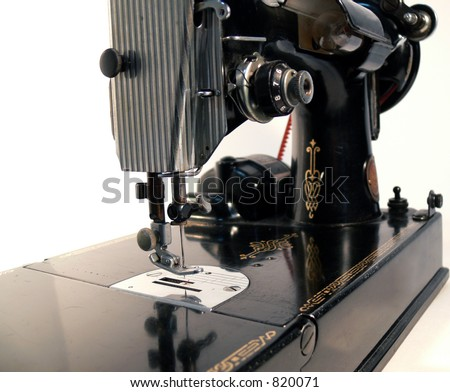 Antique Sewing Machine on White Background