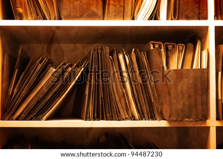 Antique Shelf full of folders and files in an office - stock photo