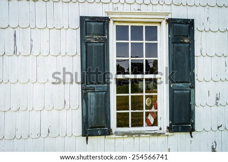 Antique siding and window in an historic old home in New Jersey. - stock photo