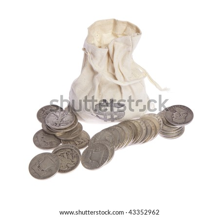 Antique silver half-dollar's with bag on white isolated - stock photo